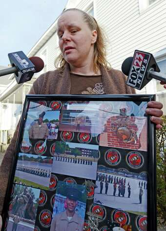 Maria Betts,  holds photos of her brother Anthony Denier who was killed in Afghanistan yesterday on the front porch of her mother's home in Mechanicville, N.Y. Dec 3, 2012.  (Skip Dickstein/Times Union) Photo: SKIP DICKSTEIN