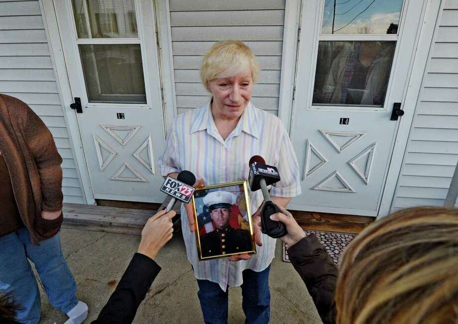 Mary Morgan speaks about her son Anthony Denier who was killed in Afghanistan yesterday on the front porch of her home in Mechanicville, N.Y. Dec 3, 2012.  (Skip Dickstein/Times Union) Photo: SKIP DICKSTEIN