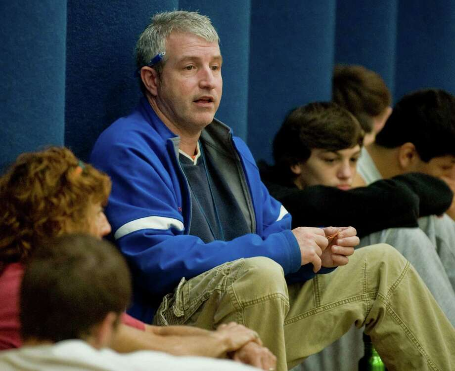 Danbury High School wrestling coach Ricky Shook talks to the team during practice. Monday, Dec. 3, 2012 Photo: Scott Mullin / The News-Times Freelance