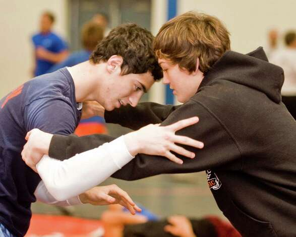 Danbury High School wrestling captains Zach Tepper, left, a senior, and Kevin Jack, a junior, work on techniques during a practice. Monday, Dec. 3, 2012 Photo: Scott Mullin