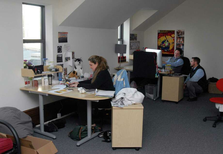 Jacquelyn Dunster, Jonathan Krackehl and Ed Massena of It's Relevent at work in their office in Old Town Hall in Stamford, Conn. on Monday December 3, 2012. Photo: Dru Nadler / Stamford Advocate Freelance