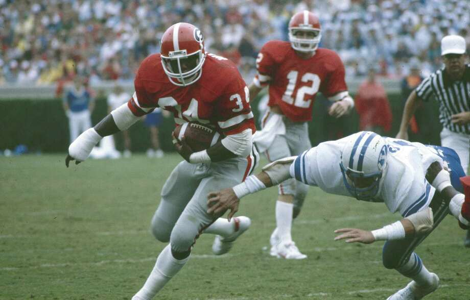 1982 Heisman Trophy winner Herschel Walker, a Georgia running back, 