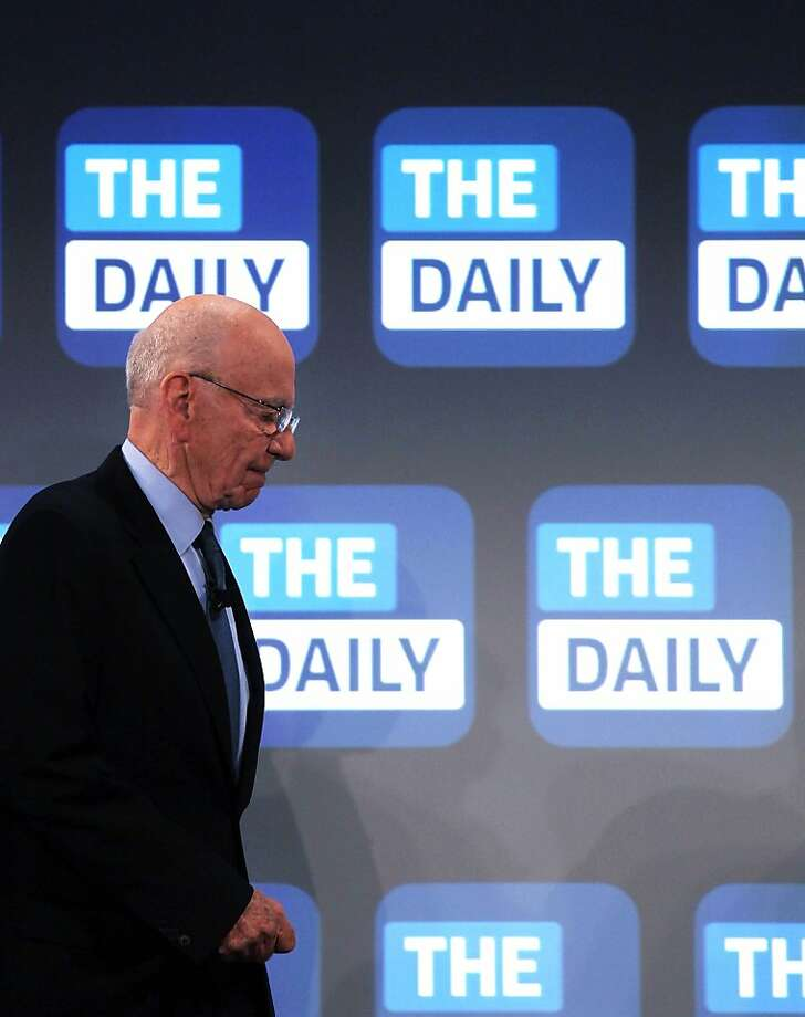 News Corp. CEO Rupert Murdoch, above, at the 2011 launch of the Daily, an iPad-only newspaper that will cease publication as part of a restructuring. Photo: Spencer Platt, Getty Images