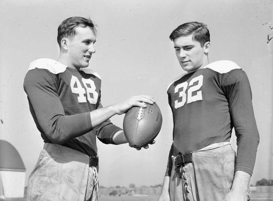 Notre Dame's Johnny Lujack, right, the 1947 Heisman Trophy winner, is shown in this Oct. 14, 1943 file photo with Angelo Bertelli, the 1943 Heisman winner. Lujack is a native of Connellsville, Pa., population 7,637 as of the 2010 Census. Photo: AP / AP