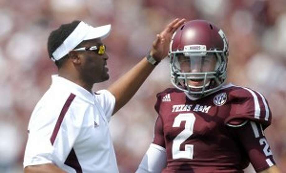 Kevin Sumlin, left, and Johnny Manziel had an award-winning debut season in the SEC. (Nick de la Torre/Chronicle)
