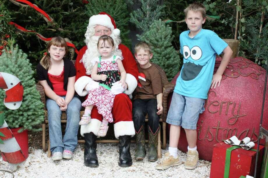 Santa Photos – Saturday, December 1, 2012 Milberger Landscaping and Nursery Photo: Express-News
