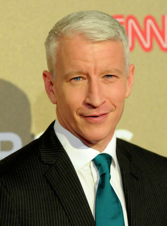 Reporter Anderson Cooper arrives at CNN Heroes at The Shrine Auditorium on Sunday, Dec. 2, 2012, in Los Angeles. (Photo by Dan Steinberg/Invision/AP) Photo: Dan Steinberg, Associated Press / Invision