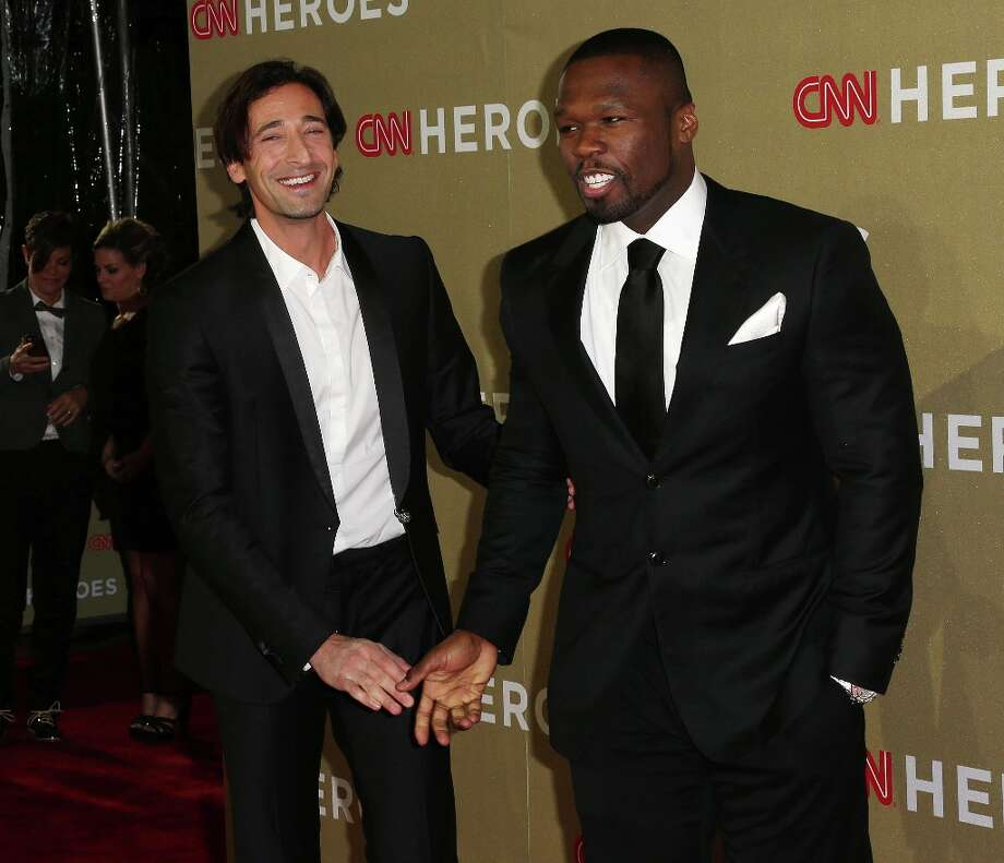 Actor Adrien Brody (L) and recording artist/actor 50 Cent attend the CNN Heroes: An All Star Tribute at The Shrine Auditorium on December 2, 2012 in Los Angeles, California.  (Photo by Frederick M. Brown/Getty Images) Photo: Frederick M. Brown, Getty Images / 2012 Getty Images