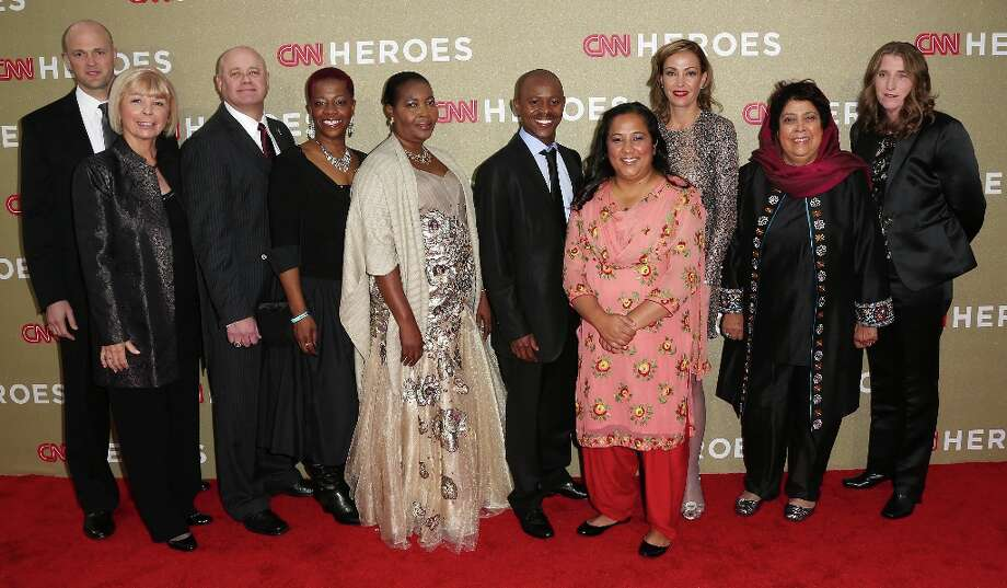 CNN Heroes attend the CNN Heroes: An All Star Tribute at The Shrine Auditorium on December 2, 2012 in Los Angeles, California.  (Photo by Frederick M. Brown/Getty Images) Photo: Frederick M. Brown, Getty Images / 2012 Getty Images