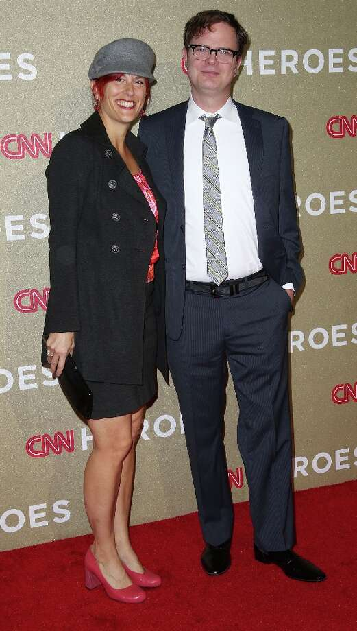 Actor Rainn Wilson and his wife attend the CNN Heroes: An All Star Tribute at The Shrine Auditorium on December 2, 2012 in Los Angeles, California.  (Photo by Frederick M. Brown/Getty Images) Photo: Frederick M. Brown, Getty Images / 2012 Getty Images