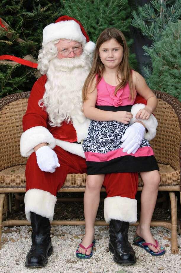 Santa Photos - Saturday, Dec. 1, 2012 Milberger Landscaping & Nursery Photo: Express-News