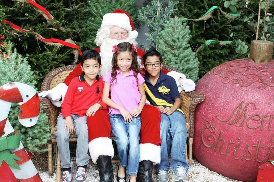 Santa Photos - Dec. 1, 2012 Milberger Landscaping & Nursery Photo: Express-News