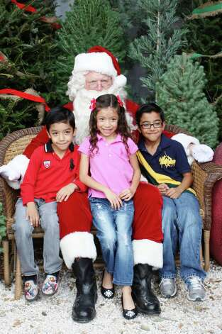 Santa Photos - Dec. 1, 2012 Milberger Landscaping & Nursery Photo: Express-News
