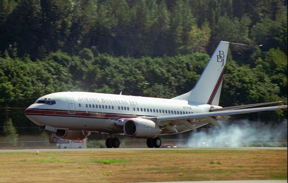 The first Boeing Business Jet lands after its first flight on Sept. 4, 1998, in Seattle.  The plane used a 737-700 fuselage, with 737-800 wings for longer range. Photo: RANDY O'BREZAR/AP, Associated Press / THE BOEING CO.