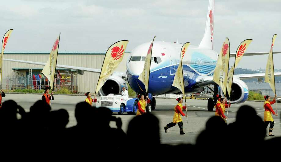 The last member of the Next-Generation 737 family is the 737-900ER. Here, Indonesian dancers accompany the roll-out of the first 737-900ER on August 8, 2006 in Renton.  Indonesia's Lion Air was the first customer for the airplane. Photo: Paul Joseph Brown