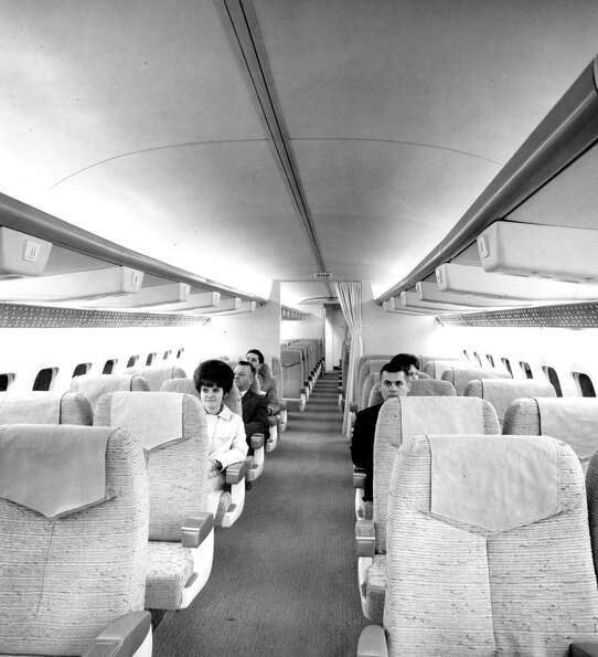 Boeing employees sit in the first-class section of a 737 interior mockup in 1966 in Renton, WA.