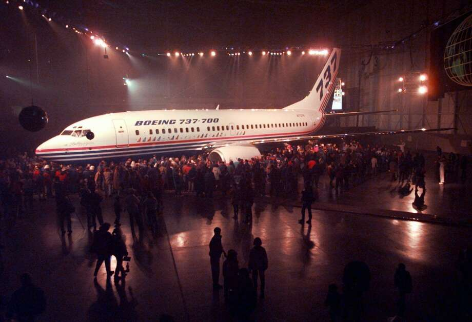 Boeing employees view a new 737-700 during a rollout ceremony on Dec. 8, 1996, in the Renton plant. Photo: ROBERT SORBO/AP, Associated Press / AP