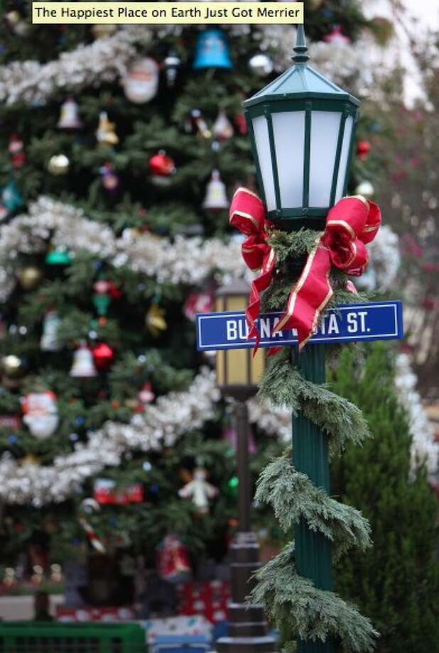 9) Walk along California Adventure's beautifully decorated Buena Vista Street, where you'll find a towering tree and the Community Bell Ringers. (Disney)