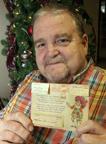 Rusty League received the card last year and has sent it on to another relative. He admitted to feeling sad before sending it, knowing that because the families are so large and spread out, he'll likely never see it again. Photo: Juanito M Garza, San Antonio Express-News / San Antonio Express-News