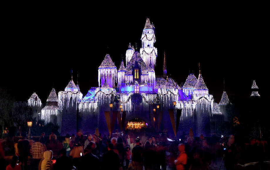 3) Be dazzled by the snow-capped turrets of Sleeping Beauty's Winter Castle, draped with shimmering icicles and twinkling lights. Photo: Paul Hiffmeyer / ©2007 Disney Enterprises, Inc. All Rights Reserved. For editorial news use only.