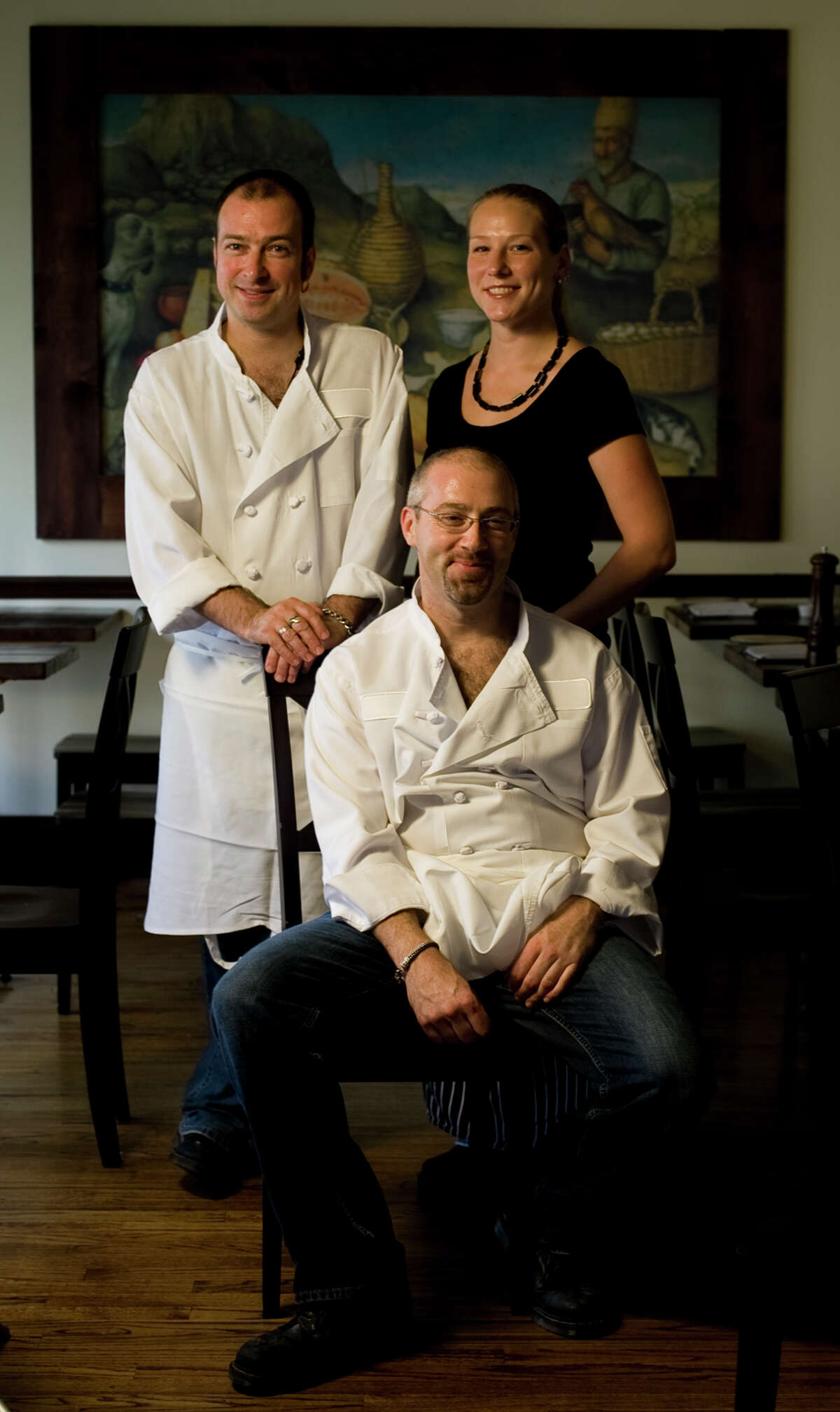Feast co-owners James Silk, left, Megan Silk and Richard Knight say doors will close in August 2013.