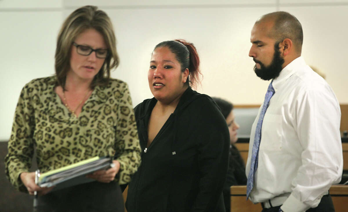Stephanie Limon Martinez (center) breaks down in a state district court in Houston during questioning at a hearing concerning custody of her children. With her are her lawyer, Casie Gotro, and her husband, Joseph Martinez.