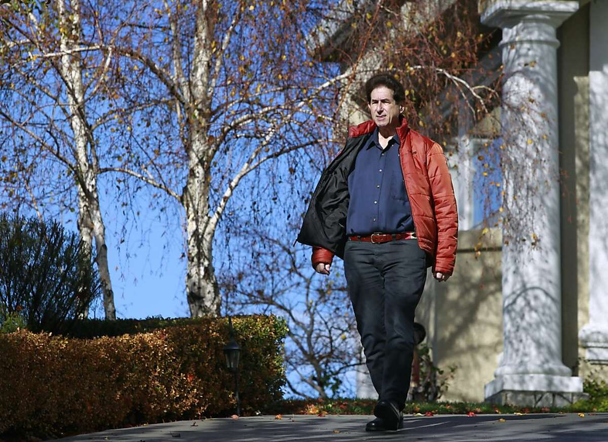 Gary Stein takes a walk near his home in Walnut Creek, Calif. on Friday, Nov. 30, 2012. Stein has lost more than 200 pounds since his bariatric surgery in 2008.