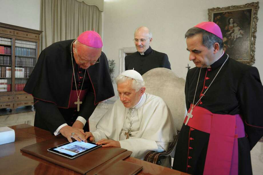 Pope Benedict XVI sends a tweet Monday for the launch of the Vatican news information portal, www.news.va at the Vatican in Rome. The Vatican said the pope will start tweeting in six languages on Dec. 12. Photo: Anonymous, HOEP / Osservatore Romano