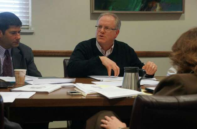 Richard Kotchko, center, Westport's purchasing officer, discusses during a Board of Finance audit subcommittee meeting the town's review of developers' proposals for a senior residential complex at the town-owned Baron's South property. At left is Board of Finance Chairman Avi Kaner; at right, facing away from the camera, is Lynn Scully, the town's internal auditor. Monday, Dec. 3, 2012/ Westport, CT Photo: Paul Schott / Westport News