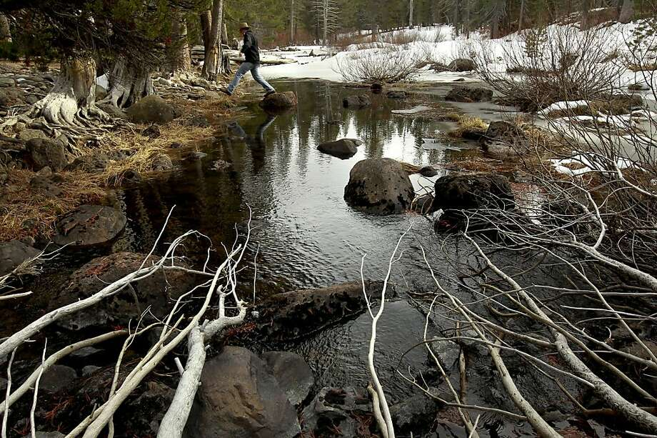 John Svahn stewarship director with the Truckee Donner Land Trust, near Truckee, Calif. on Tuesday Nov. 27, 2012, at the Little Truckee River which is part of the newly acquired property that flows from Webber Lake which is second only to Lake Tahoe as the largest contributor of water to the Truckee River. About 3,000 acres of scenic backcountry in the Sierra Nevada north of Truckee will be permanently protected under a deal announced last week by two conservation groups. Webber Lake and Lacey Meadows, located at the headwaters of the Little Truckee River, will be opened to the public for the first time in more than 100 years under the agreement. The Truckee Donner Land Trust and Trust for Public Land bought the land for $8 million from Clifton and Barbara Johnson, whose family had owned the property for nearly a century. The Johnsons used Lacey Meadows for summer sheep grazing. Photo: Michael Macor, The Chronicle