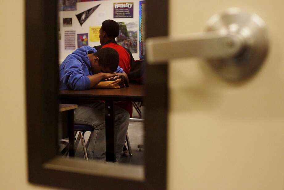 Students in a manhood development class at Oakland High School wait for the bell to ring on Nov. 27. The school district has instituted programs to help males of color succeed. Photo: Lacy Atkins, The Chronicle
