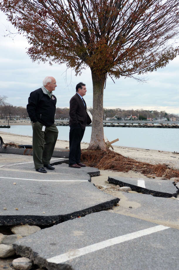 Stamford Mayor Michael Pavia and Director of Operations Ernie Orgera survey the damage to West Beach in Stamford on Thursday, Nov. 1, 2012. A city planner is working to partner with Columbia University graduate students this spring to consider ways to shield shorelines in city parks from fierce storms. Photo: Amy Mortensen / Stamford Advocate Freelance
