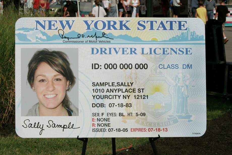 "As seen in a photo provided by the Empire Expo Center, state officials unveiled a new design for the New York State driver's license at the annual New York State Fair on Thursday, Aug. 25, 2005, in Geddes, N.Y. It incorporates a series of new security enhancements that are supposed to make the documents impossible to tamper with or duplicate. The most prominent feature is an ""optical variable device."" t's a wavy line that appears to float above the surface of the license. (AP Photo/Empire Expo Center, Mike Okoniewski) Photo: MICHAEL J. OKONIEWSKI / EMPIRE EXPO CENTER"