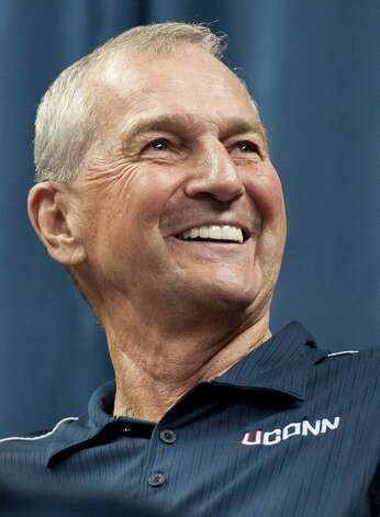 Connecticut head coach Jim Calhoun smiles during a news conference to announce his retirement in Storrs, Conn., Thursday, Sept. 13, 2012.  The 70-year-old Hall of Famer ran the men's program for 26 years and won three national titles.  Assistant coach Kevin Ollie, who played for Calhoun and was his hand-picked successor, will be introduced as the Huskies' new coach. The person familiar with the deal said Ollie will receive a one-year contract.  (AP Photo/Jessica Hill) Photo: Jessica Hill, Associated Press / FR125654 AP