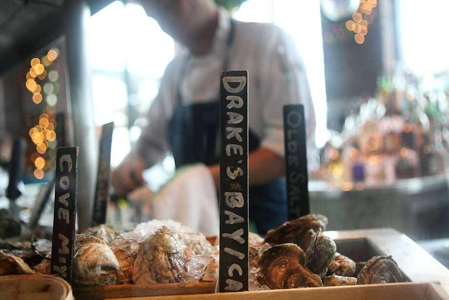 Greg Babinecz shucks oysters in San Francisco's Waterbar restaurant Thursday. Photo: Pete Kiehart, The Chronicle