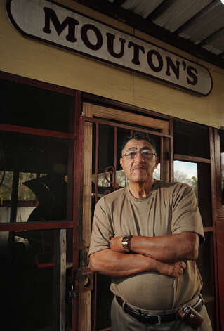 After more than 30 years of service, Edward Mouton is closing his catering business at year's end and psoting a for sale sign in the company's yard.  Photo taken Monday, December 03, 2012 Guiseppe Barranco/The Enterprise Photo: Guiseppe Barranco, STAFF PHOTOGRAPHER / The Beaumont Enterprise
