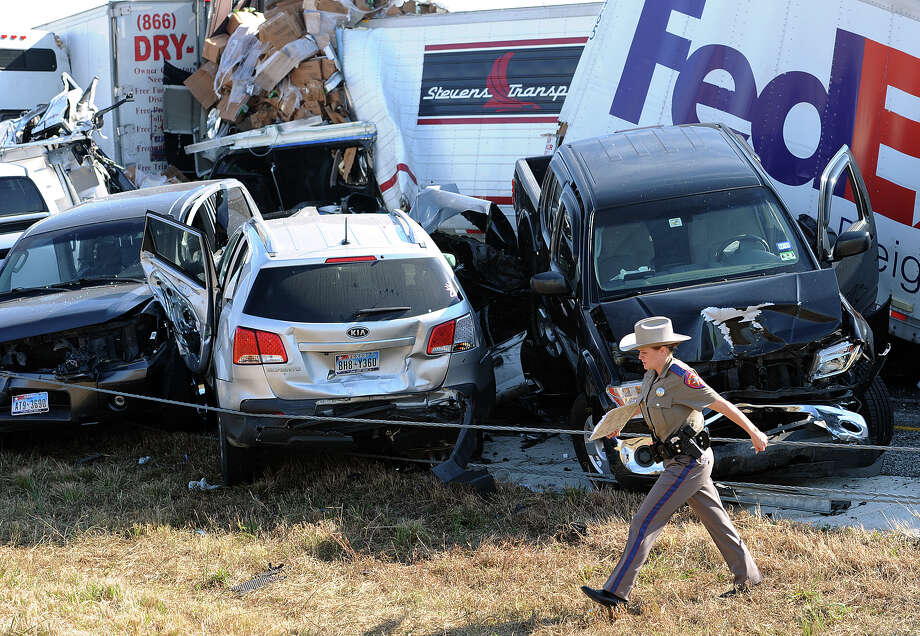 Thick fog and speed were two factors cited in the series of crashes that led to the death of a married couple and involved more than 100 vehicles on Interstate 10 Thanksgiving morning. Several large trucks were involved in the pileup. Photo: Guiseppe Barranco, STAFF PHOTOGRAPHER / The Beaumont Enterprise