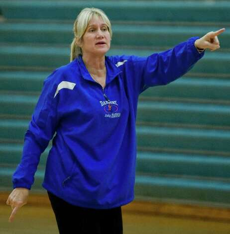 Danbury High School girls basketball coach Jackie DiNardo instucts the team in a practice session. Monday, Dec. 3, 2012 Photo: Scott Mullin / The News-Times Freelance