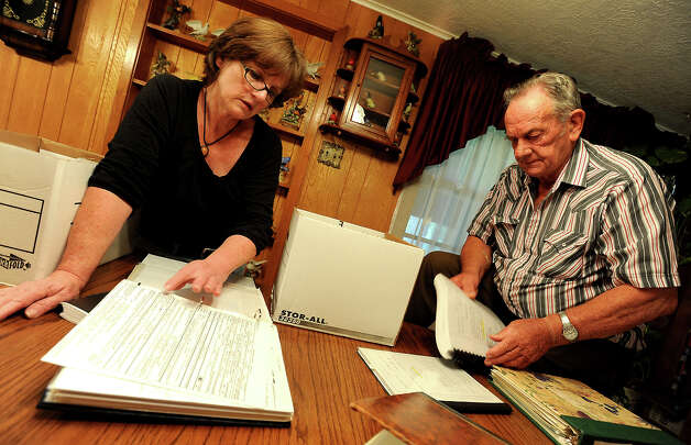 Diane Daigle and James Fulton go through some of the investigation documents from the death of Kathy Page in Rose City, Friday. It's been 20 years since Kathy Page was found murdered in her vehicle and the case remains unsolved. Tammy McKinley/The Enterprise Photo: TAMMY MCKINLEY