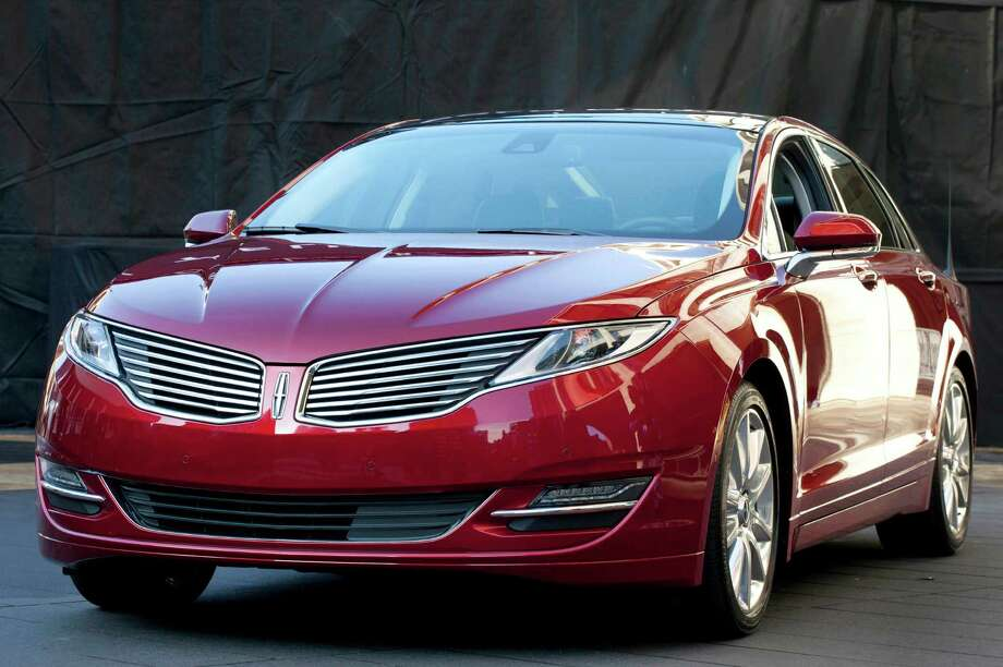 The Lincoln MKZ arrives at dealerships this month as the first of seven new or revamped Lincolns that will be going on sale by 2015. Photo: Mark Lennihan, STF / AP