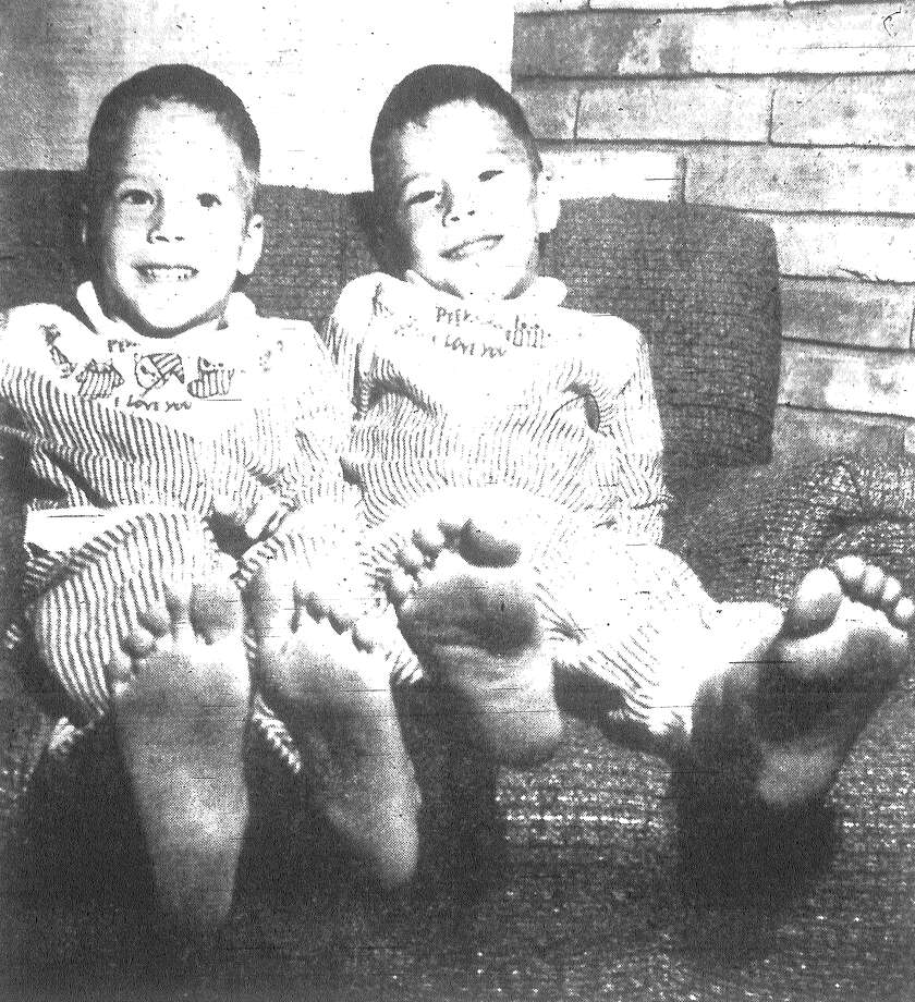 "You can bet your boots the Oyler twins are glad to be home. Steve and Gregory Oyler, both 4½ years old, took off Monday morning on an exploring trip, accompanied by their buddy, Mark McLaughlin, 3½ years old, and his dog ""Brat."" After 5½ hours of frantic searching by families, friends, neighbors, sheriff's deputies and the National Guard, the boys were found nearly 10 miles from their homes in northwestern San Antonio. They are considerably cleaner, less hungry and much less tired in this photo than when they were found by a helicopter pilot. Published in the San Antonio News Dec. 4, 1962. Photo: File Photo"