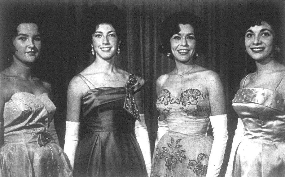 "Three of the queens of the Armed Forces who will participate in the 29th annual Black and White Ball are pictured with the president of the Selene Club, which sponsors the international ball. Left to right are Miss Linda Puig, Queen of the U.S. Navy; Miss Norma Sgalitzer, Queen of the U.S. Army; Miss Yolanda Almaguer, Selene Club President; and Miss Martha Monier, Queen of the U.S. Marines. Miss Dandy Barrett, Queen of the U.S. Air Force, was out of the city when the picture was made. Mrs. Maria R. Magnon is director and founder of the ball, which will be held Saturday in Municipal Auditorium. Fourteen girls representing various organizations will vie for the title of ""Queen of the Ball."" Published in the San Antonio Express Dec. 2, 1962. Photo: File Photo"