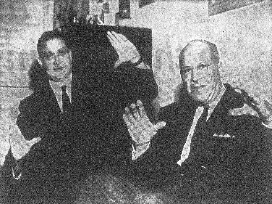 Glen A. Martin, left, of the current generation of the San Antonio petroleum industry, and H.A. Pagenkopf, who holds pioneer status, became even better friends after Martin organized his Alamo Gas Supply Co., which last year started supplying San Antonio with natural gas. Pagenkopf brought gas to the city first in 1922. Here, they illustrate the difference in the size of pipe needed then and now. Alamo gas moves in a pipe twice the size of Mr. Pag's first 12-inch line. Published in the San Antonio Express Dec. 9, 1962. Photo: File Photo