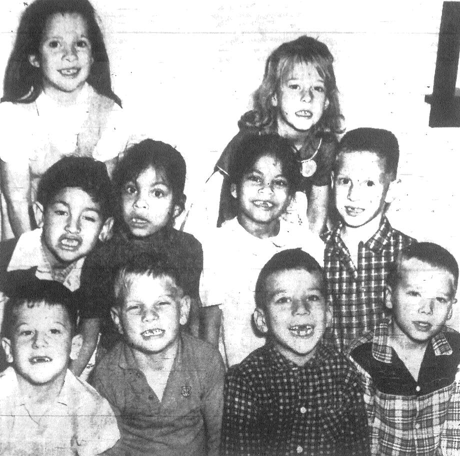 "Dear Santa Claus, all we want for Christmas is a few front ""teefe."" That's a popular chant of some of the first graders at the Woodrow Wilson Elementary School. Owners of the ""missing teefe"" are, left to right, front row, Rodney Flippen, Stephen Gibson, Al Gomez and Jerry Lewis; second row, Joe Saavedra, twins Rita and Ruth Hernandez and Dean Chase and, back row, Joanne Martin and Sheryl Dyer. Published in the San Antonio News Dec. 7, 1962. Photo: File Photo"