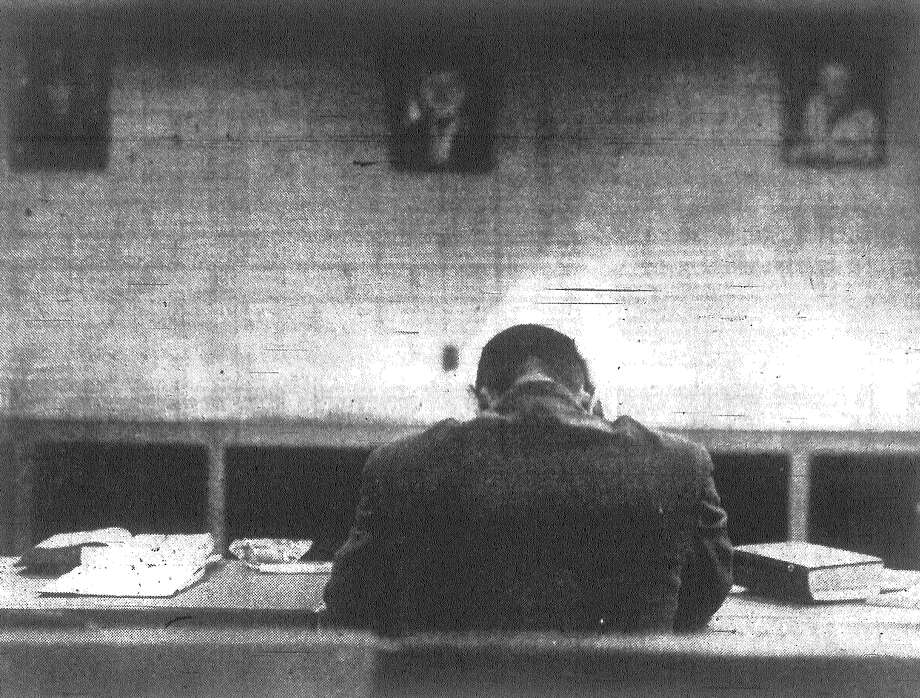 Head down, Col. John Herrington waits for the court martial board verdict in the shooting death of his wife and wounding of his mentally disabled son Wednesday. On Thursday, the eight-member court martial convicted Herrington of voluntary manslaughter and sentenced him to five years of hard labor. Published in the San Antonio News Dec. 6, 1962. Photo: File Photo