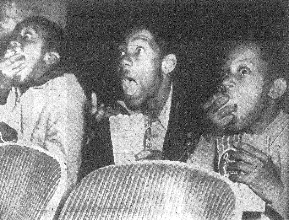 These three boys from the Ella Austin Orphans' Home got a big kick from the free movie they were treated to at the Aztec Theater Saturday by San Antonio Chamber of Commerce. Part of the annual Jaycee treat for orphans, the climax comes Thursday with the Christmas Shopping Tour for the 450 youngsters. Published in the San Antonio Express Dec. 16, 1962. Photo: File Photo