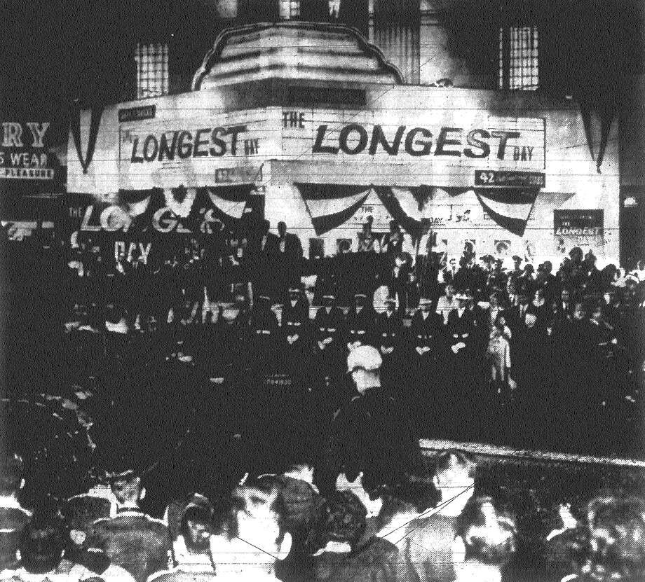 "Army troops join forces with the Chamber of Commerce to herald the opening of war film ""The Longest Day."" This scene was part of a fever-pitch pre-show demonstration in the front of Woodlawn Theater. Published in the San Antonio Light Dec. 21, 1962. Photo: File Photo"
