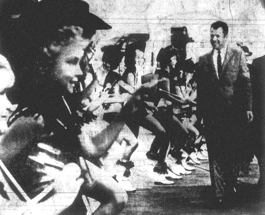 High-stepping dancers provide a lively greeting for Audie Murphy. The actor-World War II hero came to San Antonio to boost the premiere of his film depicting D-Day. Published in the San Antonio Light Dec. 20, 1962. Photo: File Photo