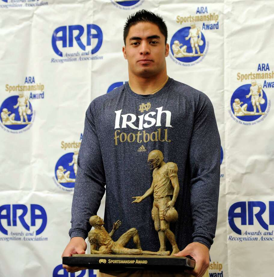 Notre Dame linebacker Manti Teo hold a sportsmanship award he received  from  the Awards and Recognition Association, Thursday, Nov. 29, 2012, in South Bend, Ind. (AP Photo/Joe Raymond) Photo: Joe Raymond, Associated Press / AP
