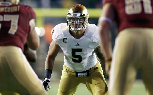 Notre Dame linebacker Manti Te'o waits for the snap during the second half of Notre Dame's 21-6 win over Boston College in a NCAA college football game in Boston Saturday, Nov. 10, 2012. (AP Photo/Winslow Townson) Photo: Winslow Townson, Associated Press / FR170221 AP